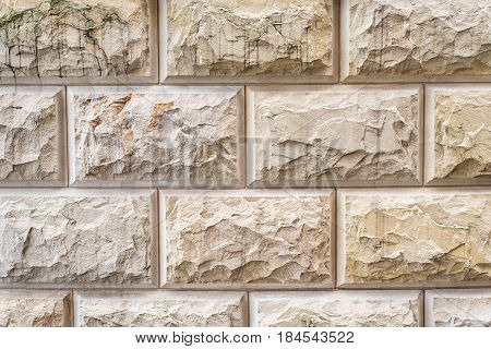 Stone background, sand wall pattern texture. Yellow natural stone facade, wall tiles