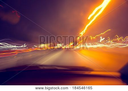 blur hi-power lightning acceleration to high speed on night superhighway road fast moving motion drive with night light trail