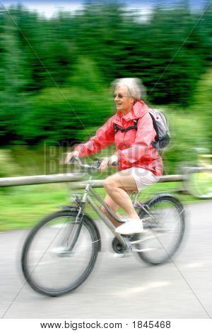 Mature Woman Enjoying A Ride On Her Bike