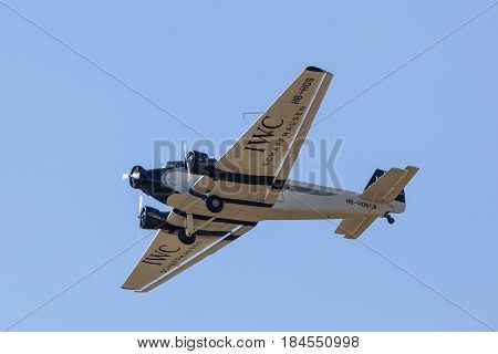 Frankfurt Germany - March 30 2017: Historic airplane Junkers Ju 52 from 1932 flying over the Frankfurt international airport