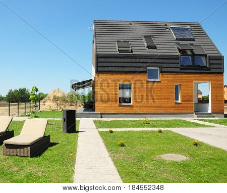 KIEV - UKRAINE MAY - 3, 2017: Modern House Construction. Solar water heating (SWH) systems use roof solar panels. Home Skylights Dormer Ventilation. Eco Smart House Energy Efficiency.
