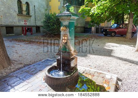 MILAN ITALY - September 06 2016: Fountain with drinking water in the street of Milan. Traditional drinking water fountain in Milan Italy