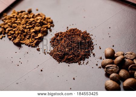 Three Heaps Of Coffee Ground, Beans And Instant, Angle Shot