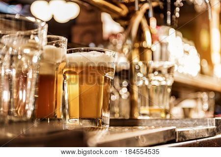 Low angle of close up mug of beer locating on table in tap-room