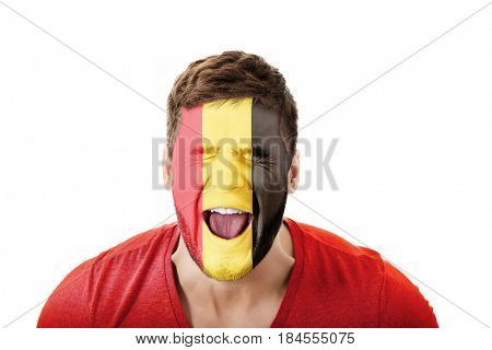 Screaming man with Belgium flag on face.