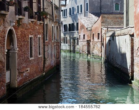 A canal in venice with light and shadow