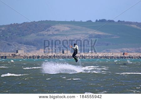 kitesurfer jumping his board in Portland harbor