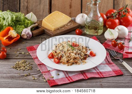 Porridge With Vegetables In Italian. Risotto With Vegetables. Still Life With A Dish And Fresh Veget