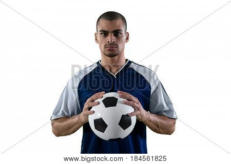 Football player holding football with both hands against white background