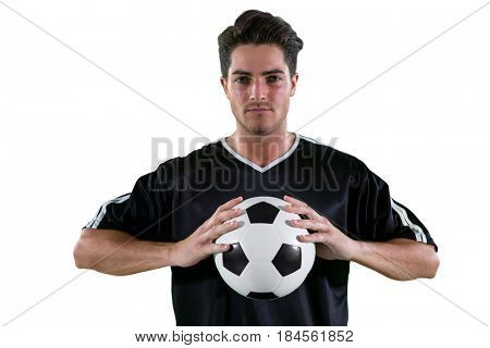 Football players holding football with both hands against white background