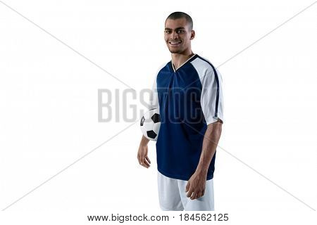 Smiling football player holding football against white background