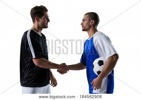Two football players shaking hands against white background