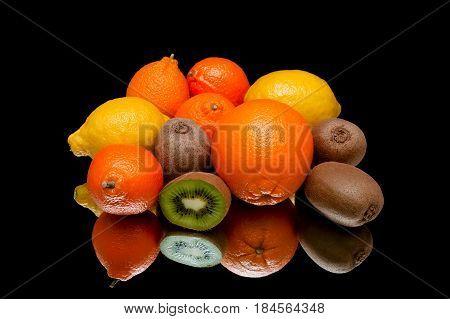 Ripe fresh fruit on a black background. Horizontal photo.