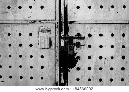 scary rusty metal door with door locked attached in white tone