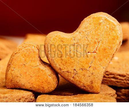 Two heart shaped cookies, closeup, fresh bakery
