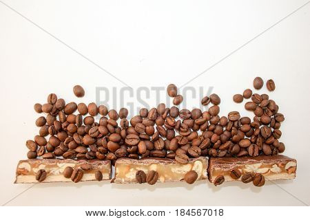 Sweet Candy With A Nut In Coffee Grains On A White