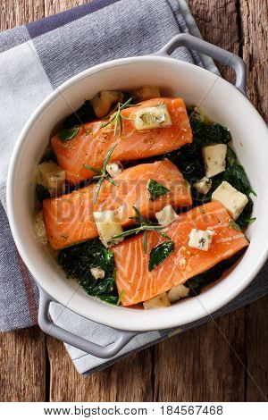 Salmon Baked With Spinach And Roquefort Cheese Close-up. Vertical Top View