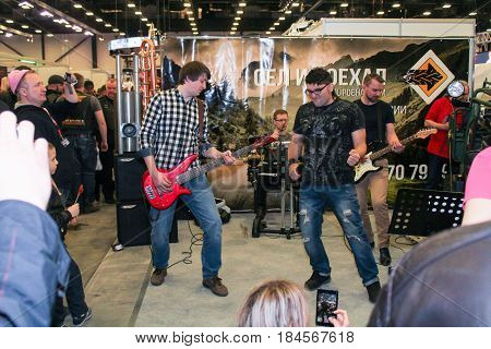 St. Petersburg Russia - 15 April, Rock band at the motor depot,15 April, 2017. International Motor Show IMIS-2017 in Expoforurum. Visitors and participants of the annual moto-salon in St. Petersburg.