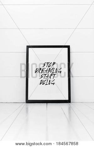 Blank frame on a white background with quotation. Stop dreaming start doing.