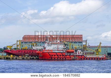 Labuan,Malaysia-June 17,2016:Multi function offshore support/platform supply vessels under repair at shipyard in Labuan,Malaysia on 17th June 2016.
