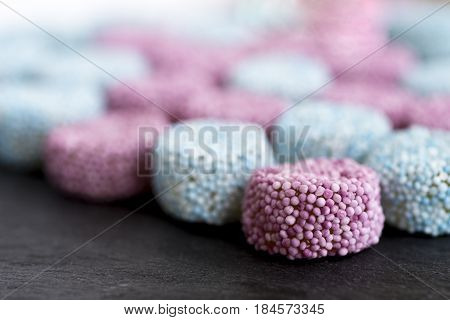 Gummy Candy Sprinkle Coated on Dark Stone Background