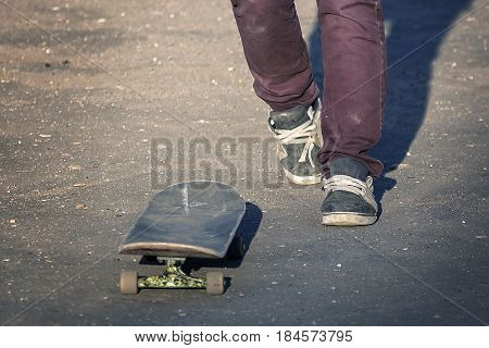 Skater rides on a skateboard in old ragged