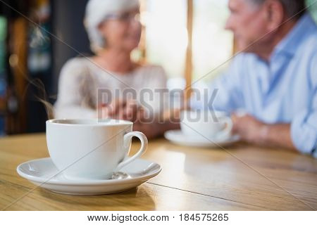 Close-up of coffee cup on table in café