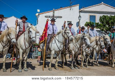 Sent-Mari-de-la-Mer, Provence, France - May 25, 2015.  Square in the center of the city. World Festival of Gypsies. Escorts - security guards on white horses before the parade