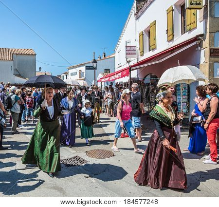Sent-Mari-de-la-Mer, Provence, France - May 25, 2015. Religious feast in honor of the Holy Maries in Provence. Women in vintage dresses and with umbrellas. The concept of ethnographic tourism