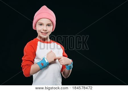 girl in sportswear with sweatband and fitness tracker isolated on black. equipment sport concept poster