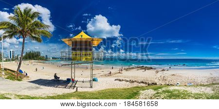 COOLANGATTA, AUS - MAY 01 2017, Snappers rock and Rainbow Bay beach with lifeguard tower, Gold Coast, Queensland, Australia