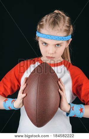 Portrait Of Little Sportive Girl With Rugby Ball Isolated On Black, Athletics Children Concept