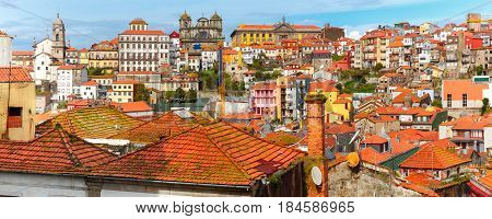 Aerial panoramic view with traditional multicolored quaint houses in Old town of Porto in the sunny day, Portugal