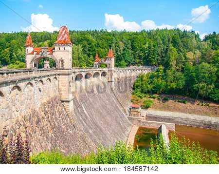 Fairytale dam Les Kralovstvi with picturesque towers on sunny summer day, Czech Republic.