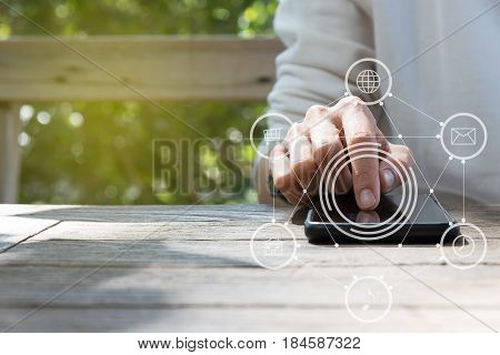People Hand Pressing Screen Of Smart Phone In Social Media Concept