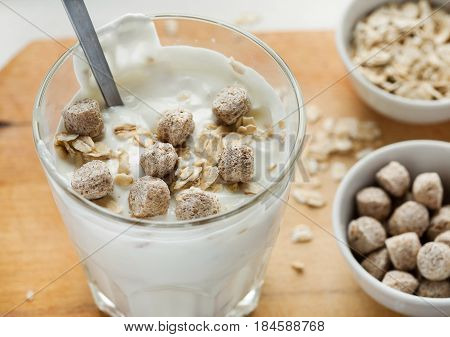 Smoothie With Wheat Bran And Oat Flakes On A Wooden Table
