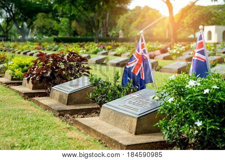 KANCHANABURI THAILAND - May 2017: Military coalition tomb tag with Flag of america in Kanchanaburi War Cemetery in Thailand.