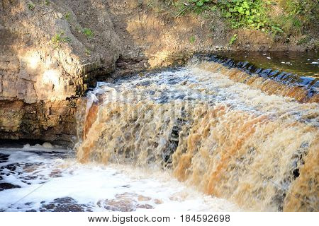 Small waterfall on Sablinka River in Leningrad Region Russia.