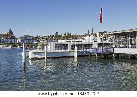 Lucerne Switzerland - May 05 2016: Painted white Catamaran Passenger Ship (Cirrus) is moored at the Ferry Terminal in the city by the Lake Lucerne.