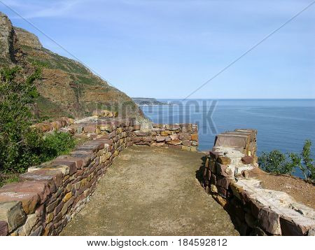 FROM CAPE TOWN SOUTH AFRICA, LANDSCAPE,PATHWAY AND MOUNTAIN SIDE IN FORE GROUND, WITH THE SEA IN THE BACK GROUND