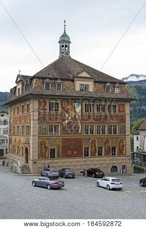 Schwyz Switzerland - May 09 2016: Town Hall with walls paintings commemorates the celebration of 600 years Swiss Confederation since the 19th century. The building itself is of 17th century