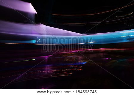 Abstract neon glowing lines or trails. Colorful lighting lights moving on dark background. Nightlife and technology