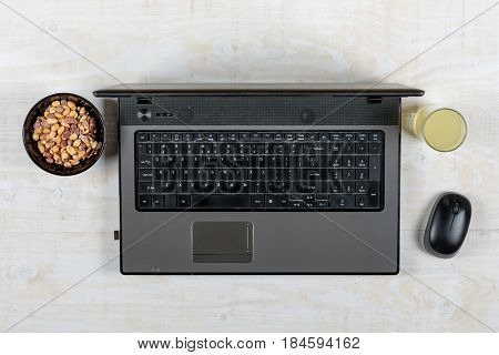 Business Lap Top Flat Lay With Peanuts And Juice