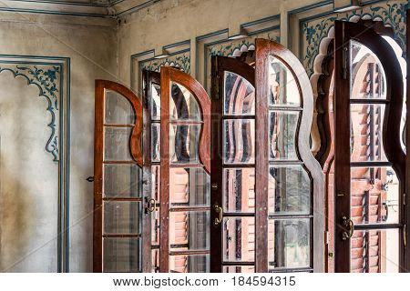Row of wooden windows at Udaipur, India.