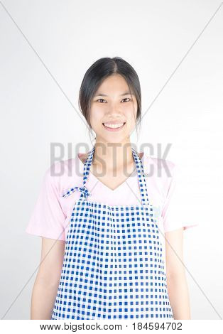 Asian house keeping maid with apron isolated on white