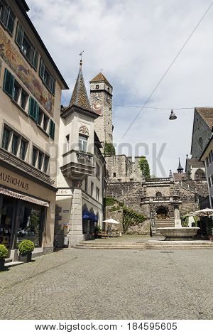 Rapperswil Switzerland - May 10 2016: The street that leads uphill to a castle. The castle clock tower is visible in the distance