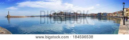CHANIA, GREECE - APRIL 3, 2017 : Panorama of the old Venetian harbour of Chania on Crete, Greece. Chania is the second largest city of Crete and the capital of the Chania regional unit.