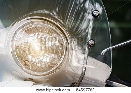 Motorcycle headlight lamp or Scooter headlight lamp with lamp light turned on and windshields.