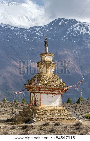 Traditional old Buddhist stupa on Annapurna Circuit Trek in Himalaya mountains, Nepal.