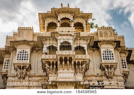 Outside wall with windows at Udaipur castle India.